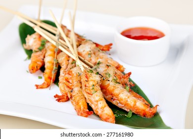 grilled shrimp on skewers with sauce