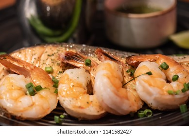 Grilled shrimp and salmon served with asparagus