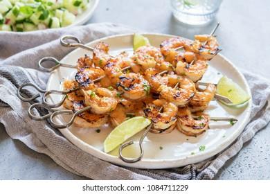 Grilled shrimp skewers with garlic honey marinade. Seafood, shellfish.