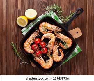 Grilled shrimps on frying pan. Top view