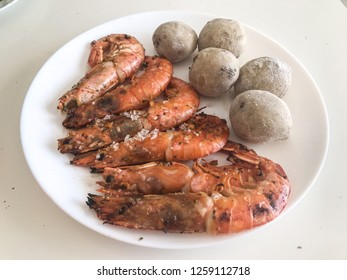 grilled shrimps with wrinkled potatoes