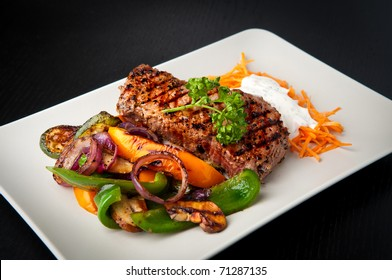 Grilled sirloin steak with grilled vegetables and carrot salad