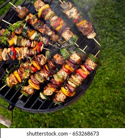 Grilled skewers on a grilled plate, top view, outdoor