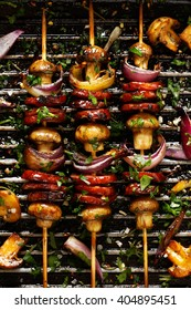Grilled Skewers of  sausage, mushrooms and onion on grill pan