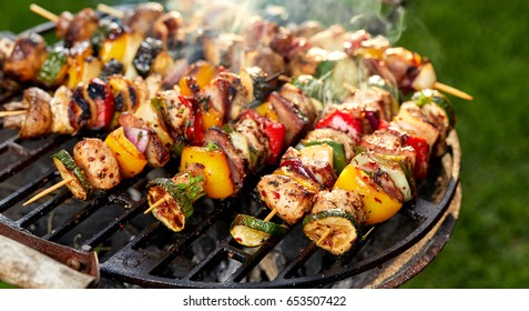 Grilled skewers of vegetables and meat on the grill, outside