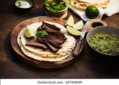 Grilled Skirt Steak Fajitas Recipe. Beef steak fajitas tacos hot tortillas.