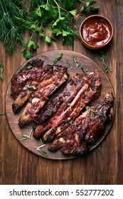 Grilled sliced barbecue pork ribs. Top view, flat lay