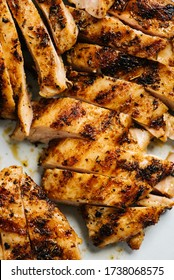 Grilled and sliced seasoned chicken breast closeup