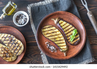 Grilled slices of aubergine with seasonings on the plate