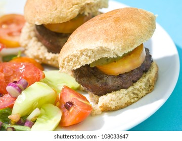 Grilled Slider Hamburgers served with a delicious fresh vegetable salad.