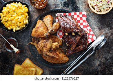 Grilled or smoked ribs and chicken with barbeque sauce, mas and cheese and cole slaw