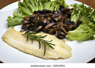 Grilled sole fish with mushrooms and herb