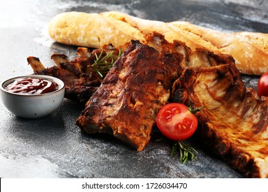 Grilled spare ribs for a tasty bbq meat with spicy barbecue sauce