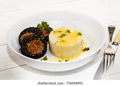 grilled spicy black and white pork pudding roll made with oatmeal and mashed potato