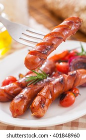 Grilled spicy sausage with onions