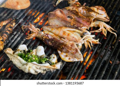 Grilled Squid street food BBQ cooking seafood.