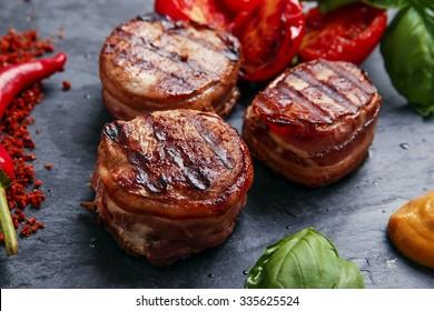 Grilled steak filet mignon wrapped bacon
