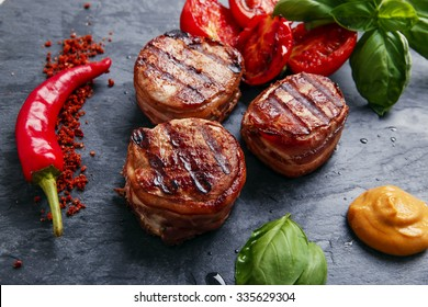 Grilled steak filet mignon wrapped bacon