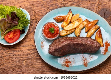 grilled steak with frech fries on wood