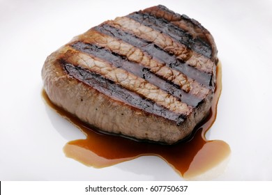 Grilled steak giving juice
