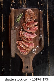 grilled steak on a cutting board. Top view.