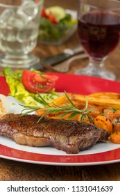 grilled steak on a plate with wine
