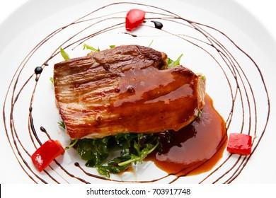 Grilled steak on white background