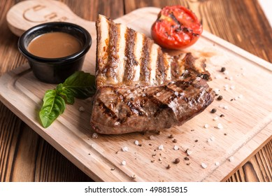 Grilled steak on wood table
