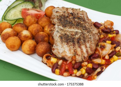 Grilled steak with potato croquettes, mexican mix