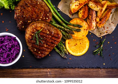 Grilled steak with potatoes and vegetables