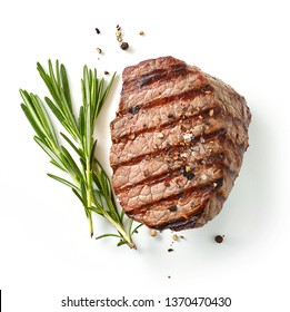 grilled steak and rosemary isolated on white background, top view