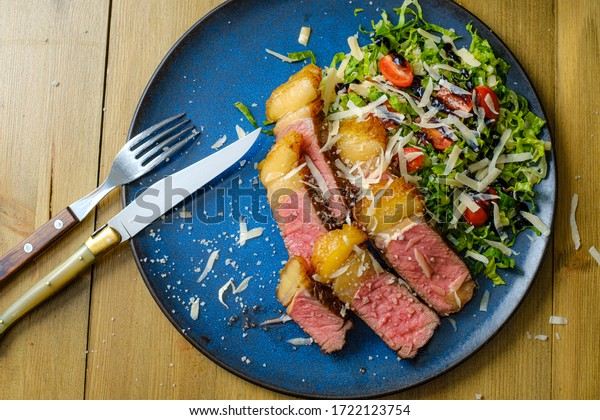 Grilled steak with salad on the side: