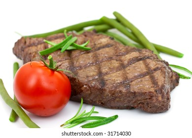 grilled steak with tomato and green beans,isolated on white