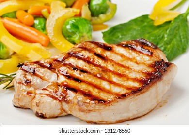 Grilled steak with vegetables on the plate