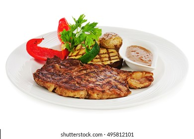 Grilled steaks, baked potatoes and vegetables on white plate isolated on white background.