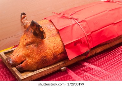 Grilled suckling pig on a table