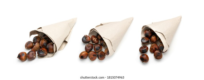 Grilled sweet whole chestnuts in a paper bags isolated. Set of baked healthy delicious chestnut, roasted veggie food