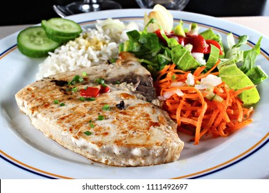Grilled sword fish steak with vegetables, shallow focus