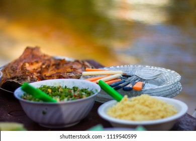Grilled 'Tambaqui' fish with local traditional side dishes including 'farofa'. Manaus, Amazonas / Brazil