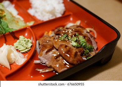 grilled teriyaki beef as part of a Japanese Bento box lunch special. A tasty healthy lunch