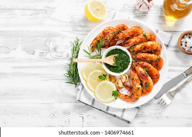 Grilled tiger shrimp with parsley sauce and lemon.