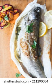 Grilled trout with lemon and butter, selective focus
