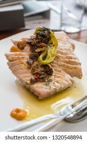 grilled tuna topped with fried garlic and dried chilli