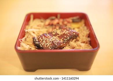 grilled Unagi eel over rice or Japanese Unagi donburi (Unadon) rice recipe.  Closeup shot