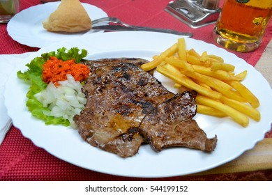 Grilled veal liver with onion, tomato salsa and french fries