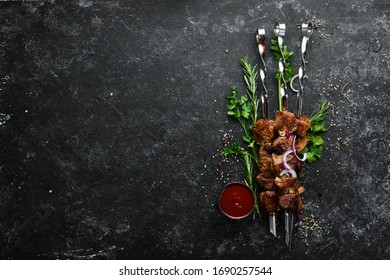 Grilled veal skewers and grilled vegetables. Top view. Barbecue.