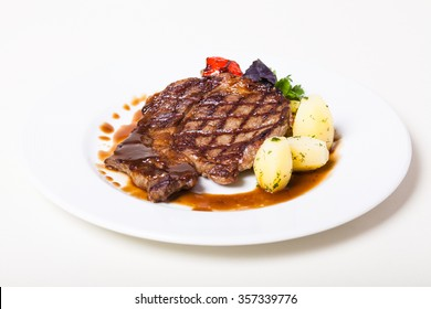 Grilled veal stake with vegetables on a plate