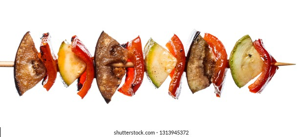 Grilled vegetable kebab on skewer with tomato, pepper, zucchini, squash and eggplant on white background, isolated food