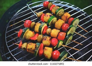 Grilled vegetable skewers on barbecue