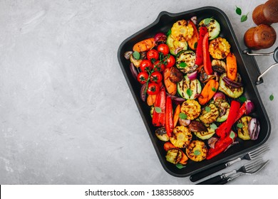 Grilled vegetables in a cast iron pan. Top view, copy space